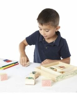 Boy playing with Dinosaur Stamp Set
